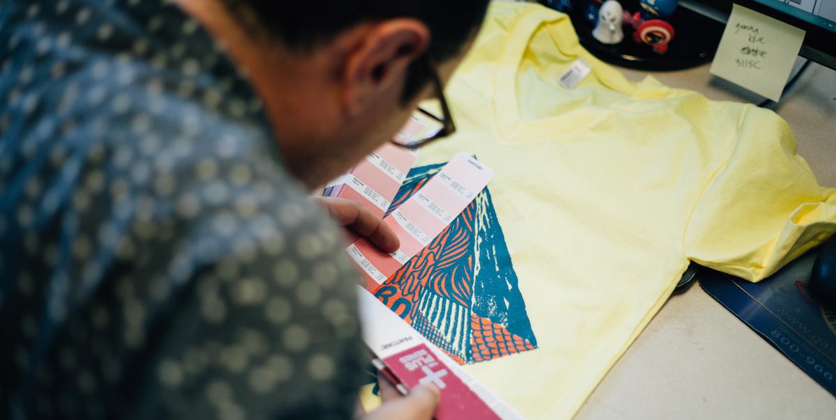 Man looking at t-shirt